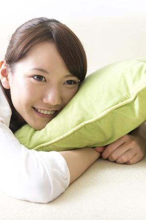 lie down: Women lie down on the sofa