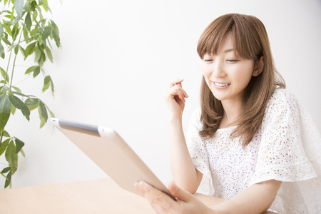 Woman using Tablet PC photo