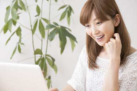 Women touch notebook PC Stock Photo
