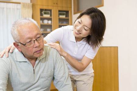 Care workers to encourage grandfather Stock Photo