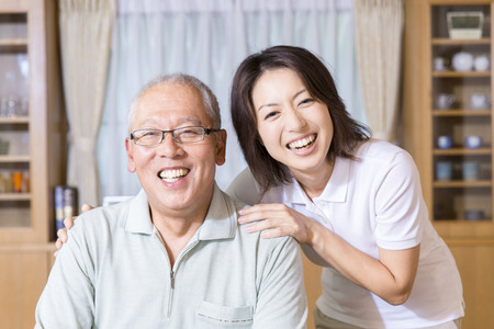 Senior men and care workers of smile