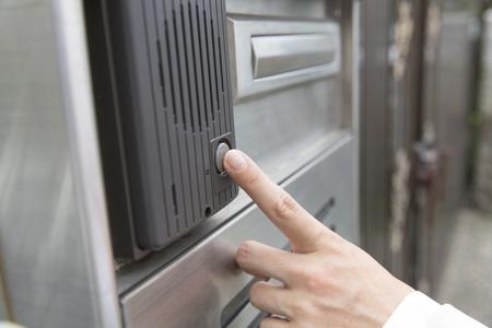interphone: Woman to press the intercom