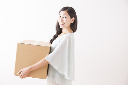 dwellings: woman with package Stock Photo