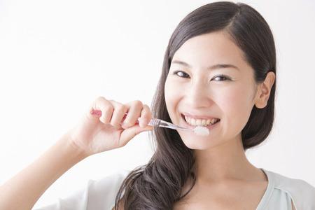 Women brush their teeth