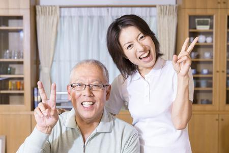 senior men: Senior men and care workers of smile