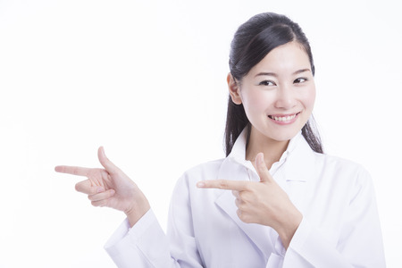 Woman doctor pointing to