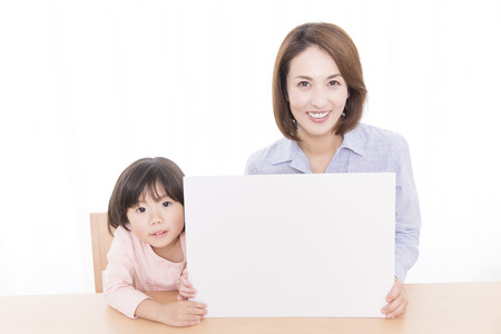 message board: Mother and daughter with a message board
