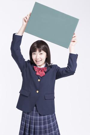high school girl: High school girl with a message board