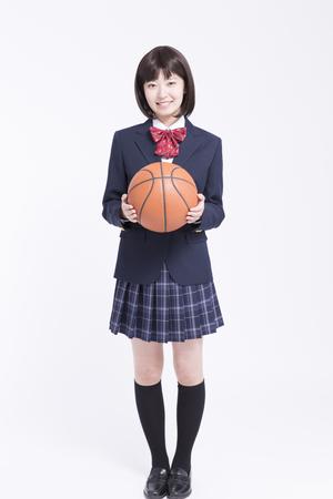high school girl: High school girl with a basket ball Stock Photo