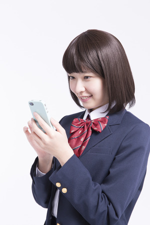 Female high school students to work with Smartphones photo