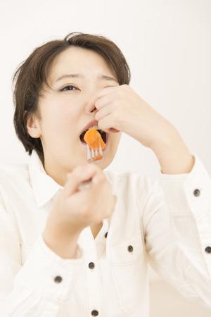 hesitant: The hesitant woman to eat carrots
