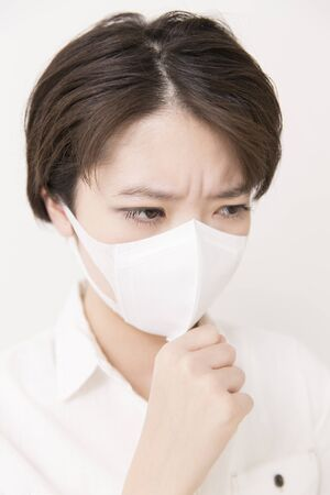 agonizing: Female using masker Stock Photo