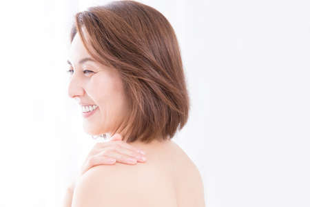 stiffness: Smiling woman Stock Photo