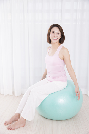 balance ball: Women get on the balance ball
