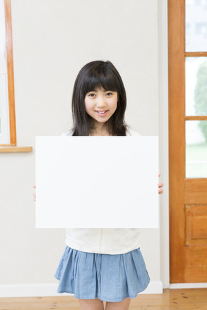 one room school house: Girl with a message board Stock Photo