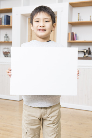 one people: Boy with the message board