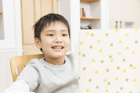 one room school house: Boy reading book