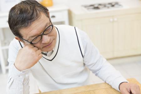 the elderly residence: Senior put elbows on the table men