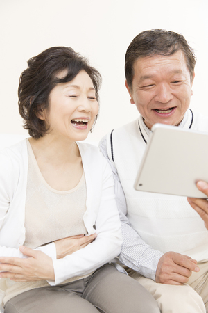 Senior couple with a tablet PC
