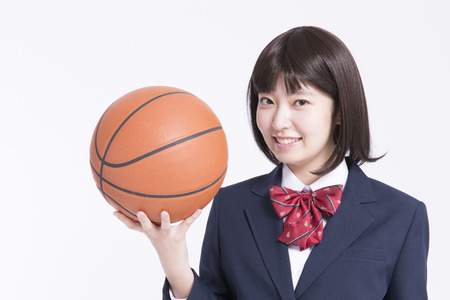High school girl with a basket ball Stock Photo