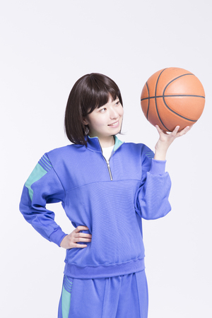 10s: High school girl with a basket ball Stock Photo