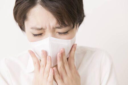 sneezing: A woman sneezing
