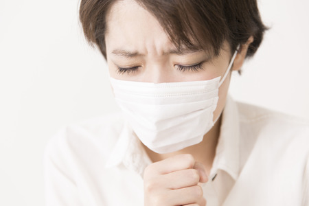 agonizing: Female cough Stock Photo