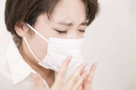 agonizing: A woman sneezing