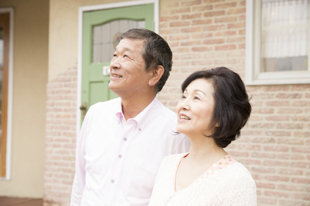 the elderly residence: Senior couple look up at the sky