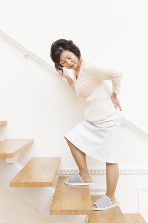 the elderly residence: Senior women who feel uncomfortable at the waist Stock Photo