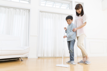 Mother and son to clean Stock Photo