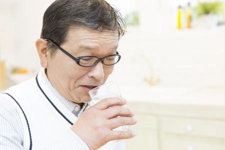 Senior men drinking water