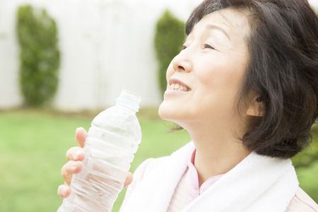 the elderly residence: Senior woman drinking water