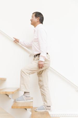 the elderly residence: Senior men climb the stairs