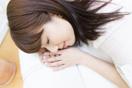 lie down: Women lie down Stock Photo