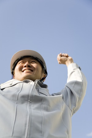 workingman: Businessmen smile to raise the arm