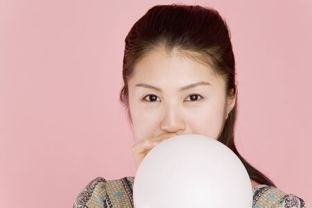 to inflate: Woman to inflate the balloon Stock Photo