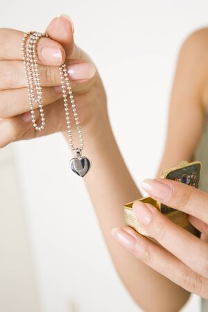 being the case: Hand with a necklace Stock Photo