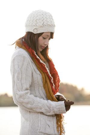 Woman looking downverso