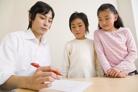 Teachers and students in scoring Stock Photo