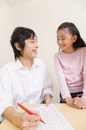 taught man: Teachers and students in scoring Stock Photo