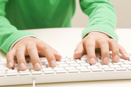 manipulate: The hands of children to manipulate the keyboard