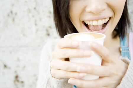 delight: Mouth of women who drink a latte