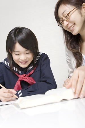 centralised: Cram school instructor to teach the study in junior high school girls Stock Photo