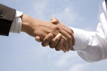 手握手ビジネスマン 写真素材