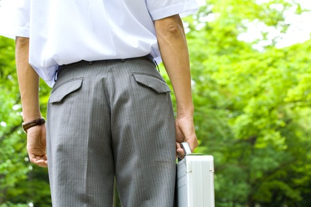 short sleeved: Rear View of businessman with attache case Stock Photo