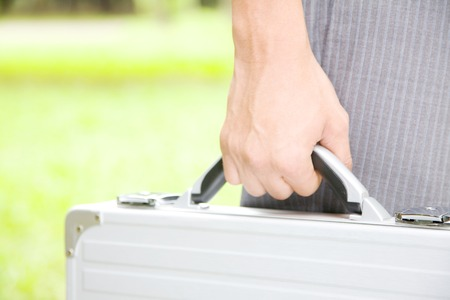 attache: Hand of businessman with an attache case Stock Photo