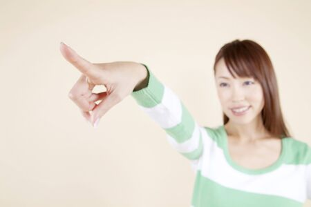 living beings: Woman pointing to a distant finger Stock Photo