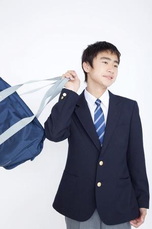 Junior high school boy with a bag