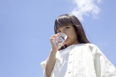 rehydration: Girl drinking a glass of water